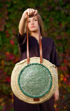 Green round carrycot