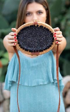 Black oval rattan bag